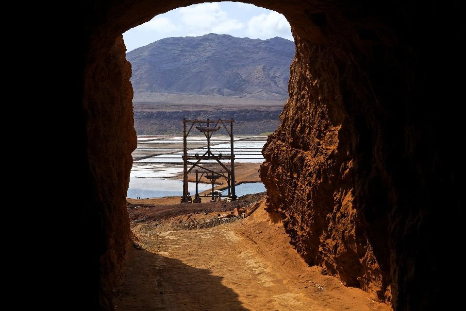 salt-mine-tunnel-with-opening-to-a-canyon-landscape
