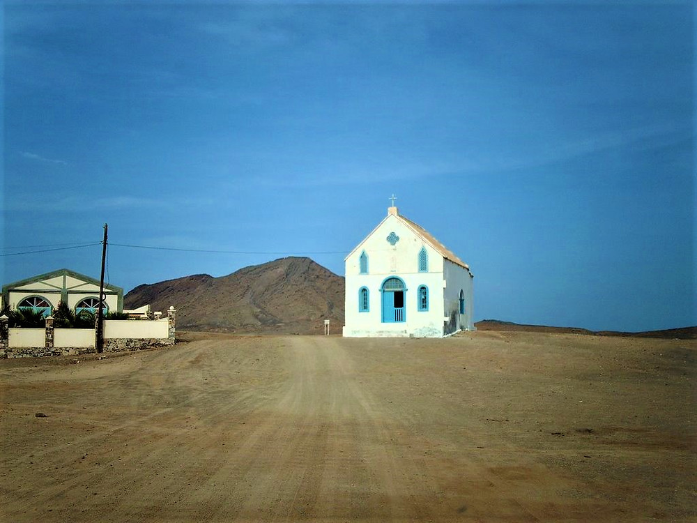 white-and-blue-dreamlike-chapel-in-a-lunar-landscape