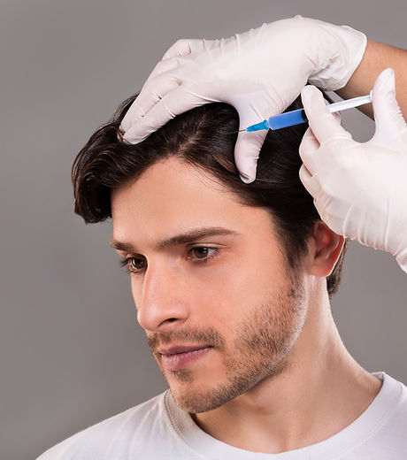 Man with hair loss problem receiving inj