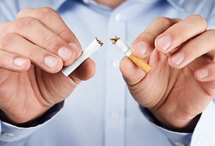 Quit smoking, human hands breaking the c