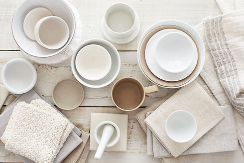 white plates and bowls on wooden table