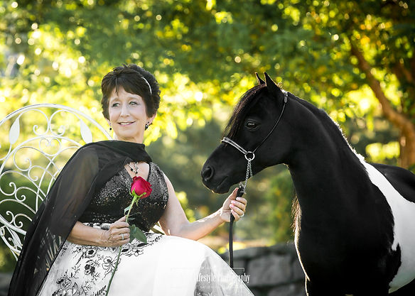 Lady in dress and rose with her award winning miniature stallion Ragtime during our photo shoot