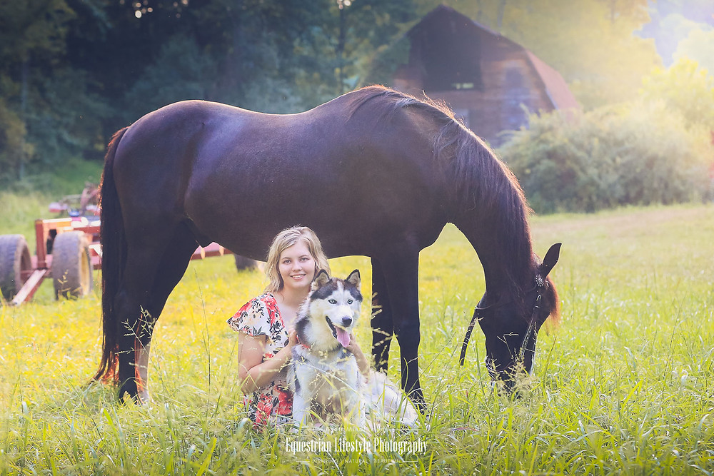 Graduate Breauna with her horse Blaze and her Huskie dog
