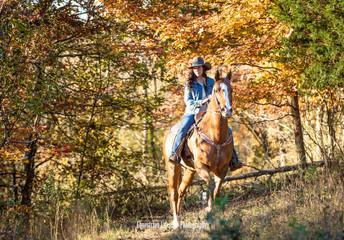 Cowgirl trail riding during Fall Season