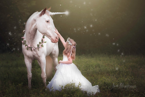 Unicorn and Nora looking at each other.j