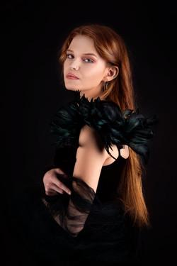 atlanta studio photo session elegant beautiful woman in black dress with feathers