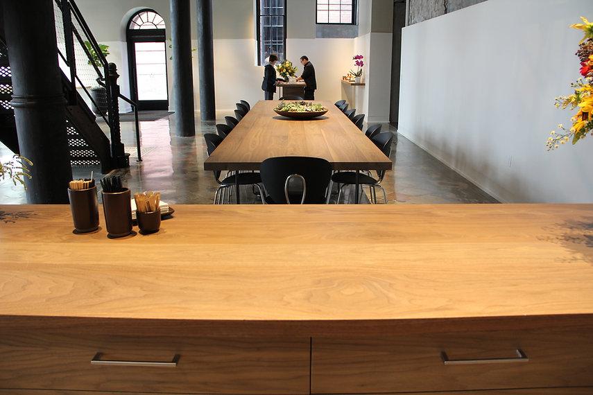 "50"" x 20' walnut community table"