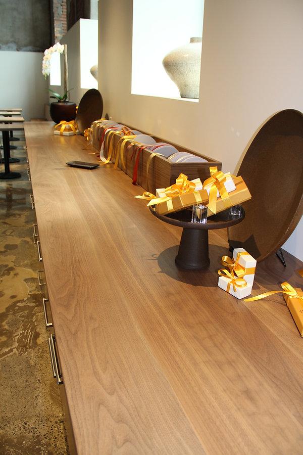 24' walnut wrap and ribbon table with custom ribbon holder