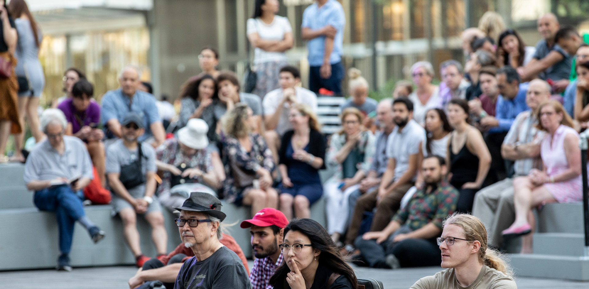 """Audience members watch """"When We Took The Fire"""" at The Shed Plaza."""