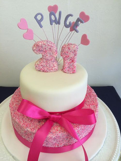 2 tier 21st cake with edible sprinkl
