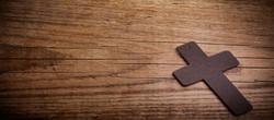 brown cross on wood