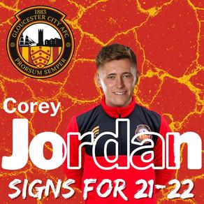 Corey Jordan signs