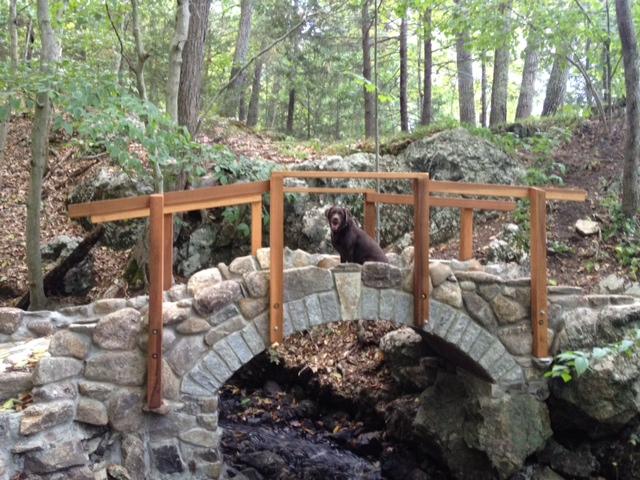 Lee's Bridge with brown lab sitting on it
