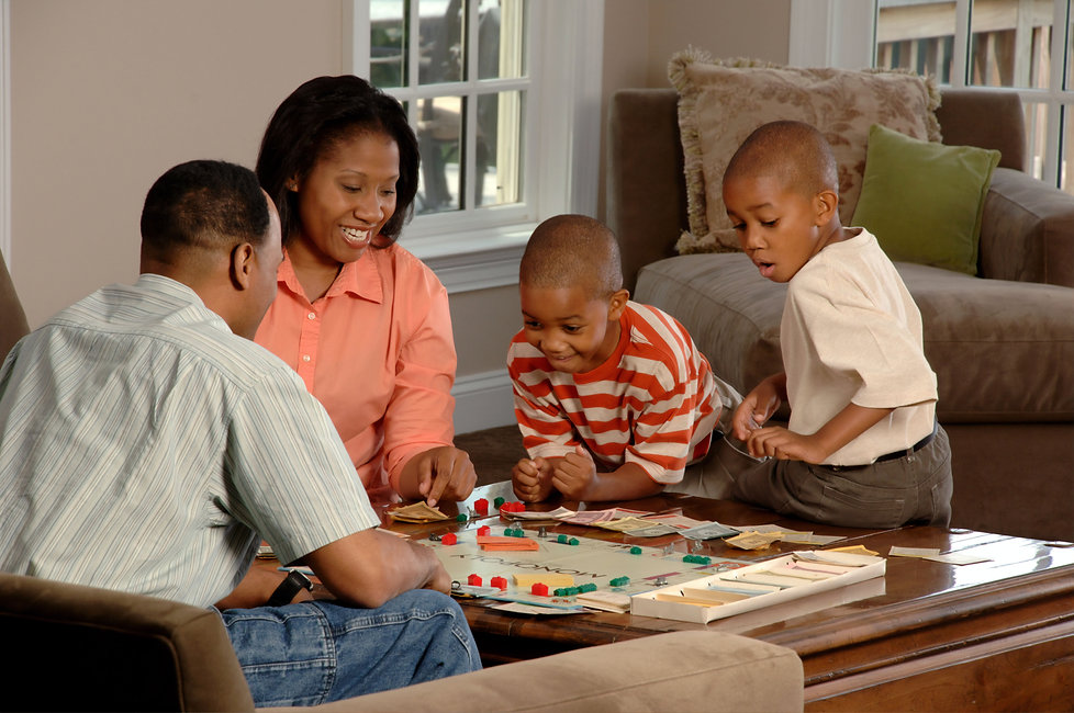 Happy family playing games in their home