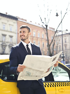 man-holding-newspaper-1843360_edited.jpg