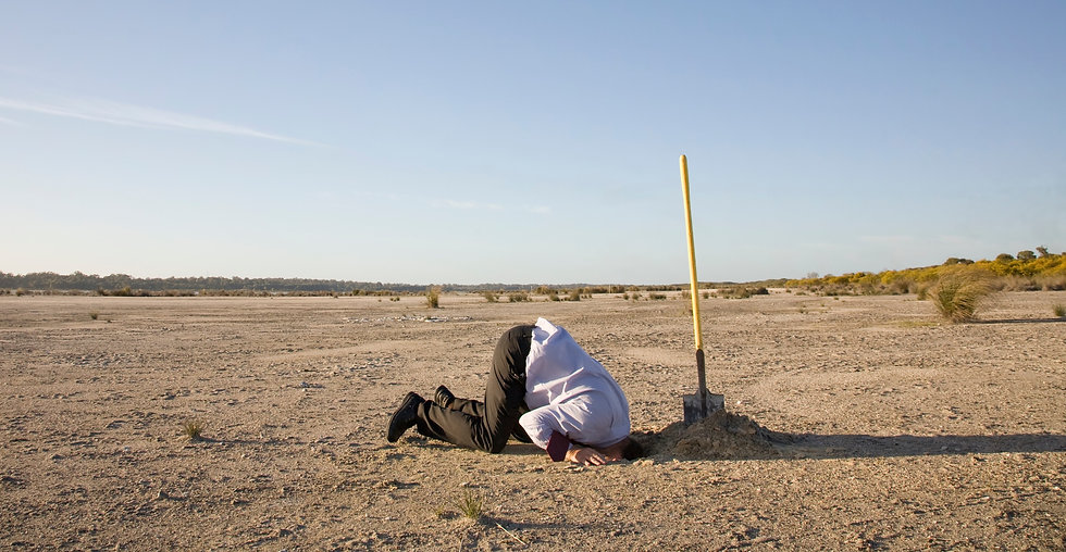 A powerful denial concept, man with his head in the sand._edited.jpg