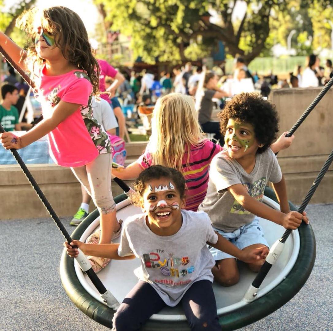 kids on swing pic.JPG