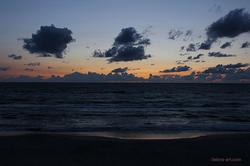 The Sun Setting at Sea