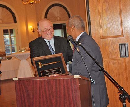 Incoming SSMMA President Vernard Alsberry, Jr. (right) presents outgoing President John Ostenburg with a plaque of appreciation for his service.