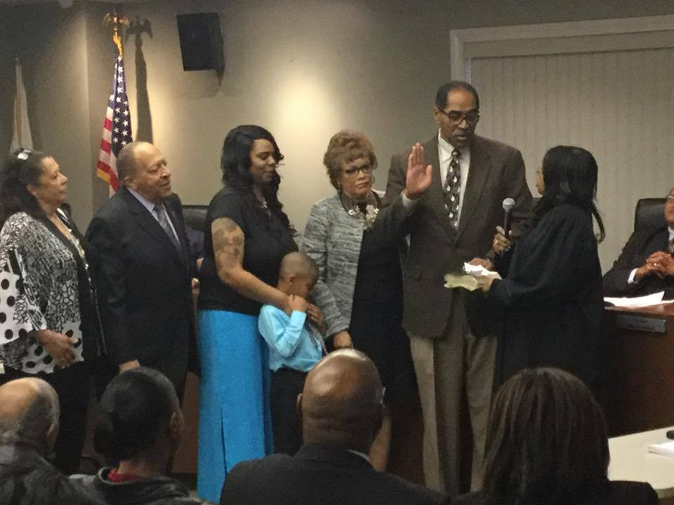 New Olympia Fields Mayor Sterling Burke is sworn in Monday, May 8th, 2017 at the Olympia Fields Village Hall  by Judge Drella Savage. Image courtesy of Thomas Savage, Sr./Facebook