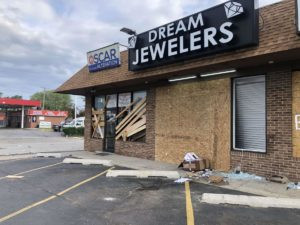 Sheriff's police help clean up businesses damaged by looters, but they can't fix inequality