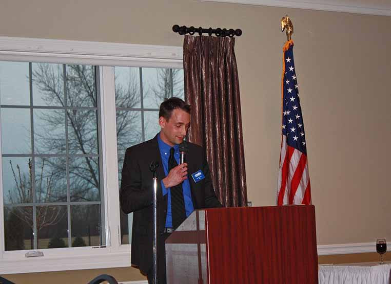 Tom Vander Woude provides s a transportation report at  SSMMA's March 2015 dinner meeting at Glenwoodie Golf Club.