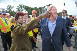 Dixmoor Mayor Dorothy Armstrong with Gov. Pat Quinn at Sept. 5th girder signing event. Photo by Harvey S. Tillis