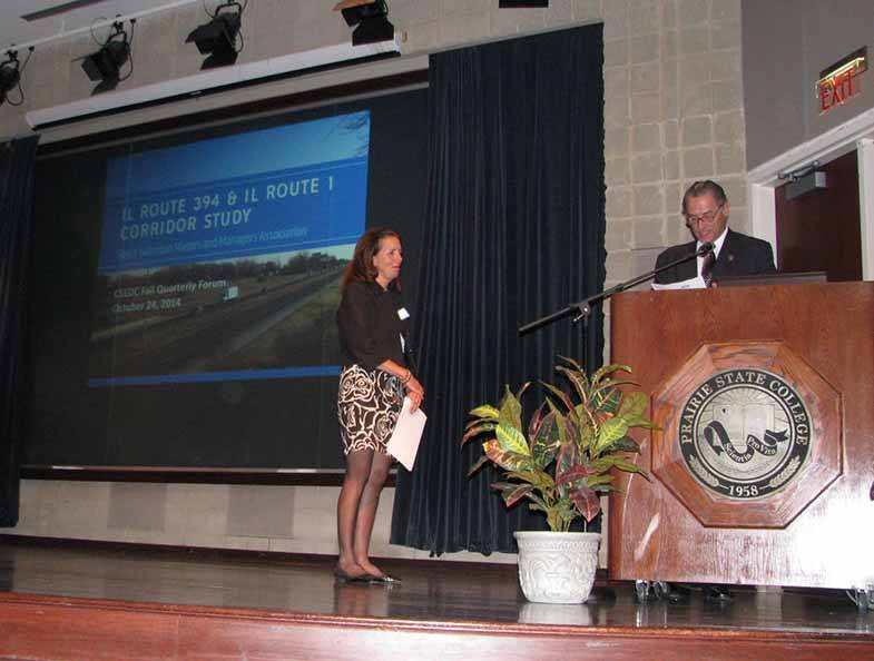 Mayor Richard Reinbold introduces Gina Trimarco at the fall quarterly forum held at Prairie State College.