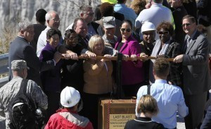 Elected officials and Metropolitan Water Reclamation District commissioners stand beside a fake dynamite plunger for a photo opportunity as they gather before the last blast signals the end of major excavation at the Thornton Reservoir. Photo by Antonio Perez, Chicago Tribune.