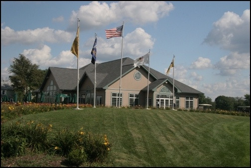university-golf-club-clubhouse-small-image-with-flags