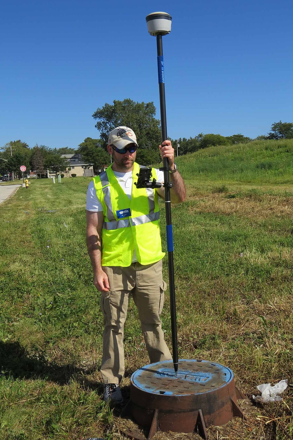 GIS Analyst Chris Poshek uses a new GPS unit in Calumet Park to capture infrastructure data for mapping.