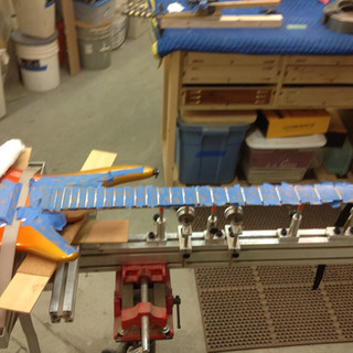 guitar in neck jig for fretwork