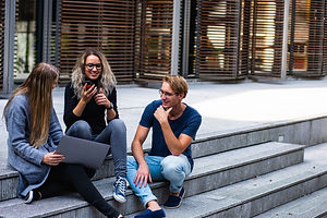three-persons-sitting-on-the-stairs-talk