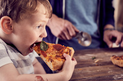 kid with pizza