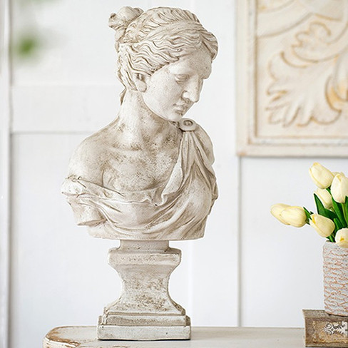 weathered woman bust statue