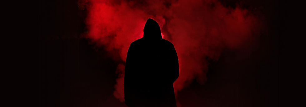 scary silhouette around a dark red background