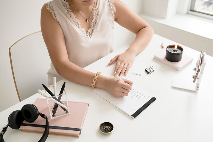 girl entrepreneur writing on notepad