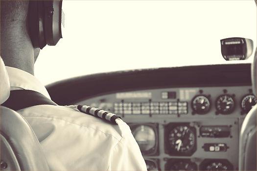 pilot sitting at controls