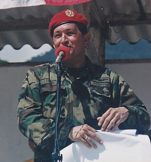 Venezuela's Chavez speaking at podium