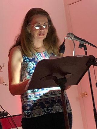 Christina Hoag at podium speaking