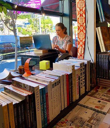 Christina Hoag sitting in bookstore window