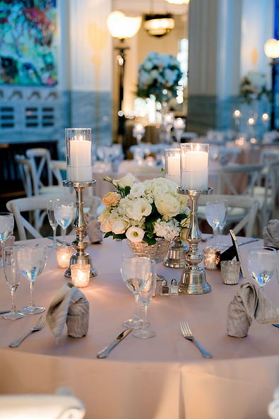 Shedd-Aquarium-wedding-white-centerpiece-silver-candlesticks-Chicago-Illinois