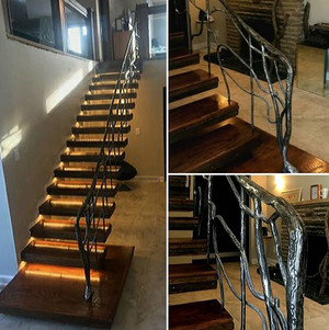 Custom Oak staircase with hand forged handrail and LED step lighting.jpg