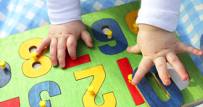 infant-hands-learning-motor-skills-with-
