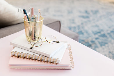 pink workspace with pens