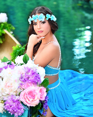 quinceanera photos with canoe and flowers