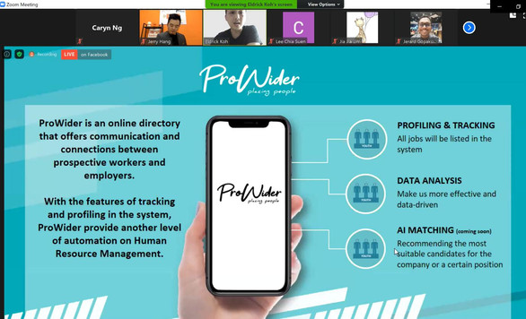 Eldrick explaining the ProWider app which connects prospective workers and employers