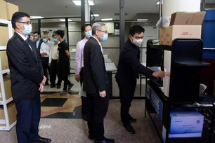 Then (far right) explaining the e-commerce system to guests during the tour.