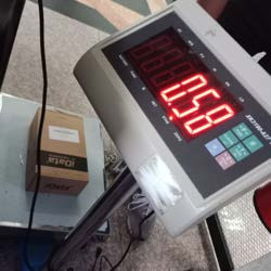 Measuring product weight before printing the barcode for the product.