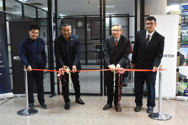 Prof Max Shangkar (second from left) and Prof Ewe cutting the ribbon as Then (far left) and Prof Faidz (far right) look on during the launch.
